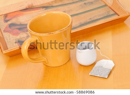 Large Cup and Tea Bag and Steeping Cup - stock photo