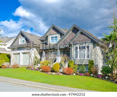 Large custom built luxury house in a residential neighborhood.  Vancouver, Canada - stock photo