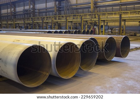 Large diameter pipes are in industrial workshop - stock photo
