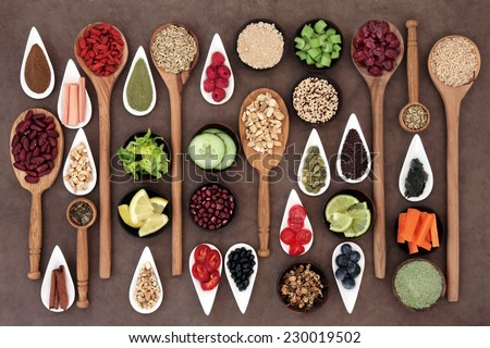 Large diet and weight loss superfood selection in bowls and spoons over lokta paper background. - stock photo