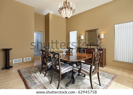 Large dining room with tan colored walls - stock photo