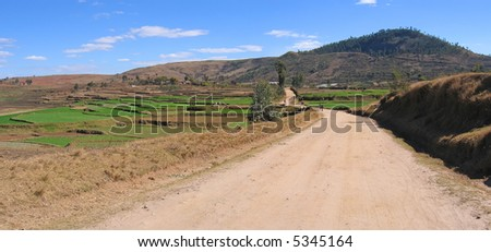 Large dirty track in the country - Antsirabe - Madagascar - Panoramique. - stock photo
