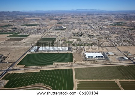 Large distribution warehouses at the edge of agriculture - stock photo