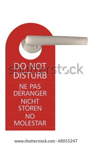 Large Do Not Disturb Tag And Door Handle, Isolated, English, French, German, Spanish - stock photo