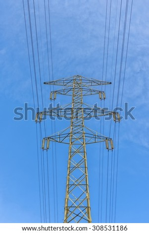 Large electric pylon with blue sky angle shot