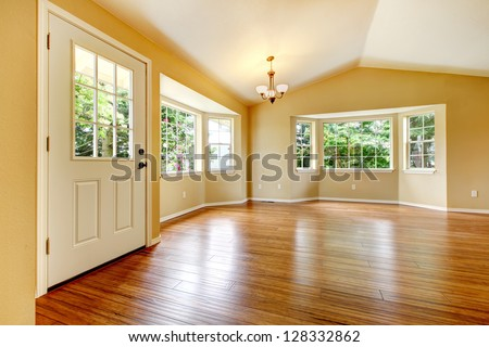 Large empty newly remodeled living room with wood floor. - stock photo