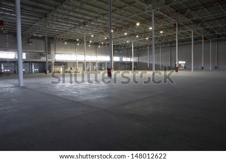 Large empty storehouse - stock photo