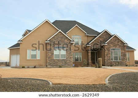 Large expensive modern house with stone on front - stock photo