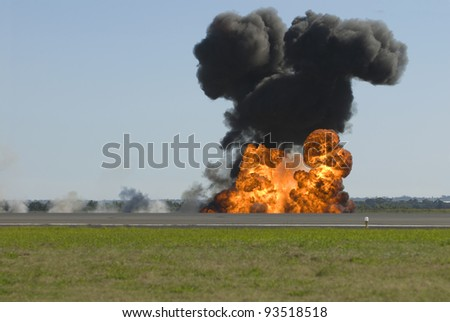 Large explosion on airport runway - stock photo