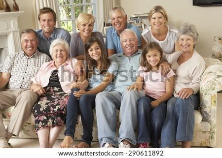 Large Family Group Sitting On Sofa Indoors - stock photo