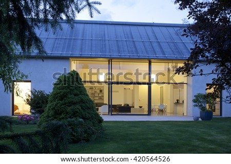 large family house at night with garden