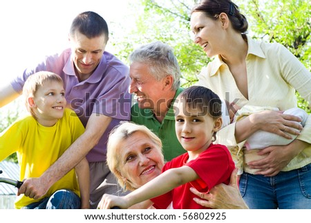 large family plays in the park - stock photo
