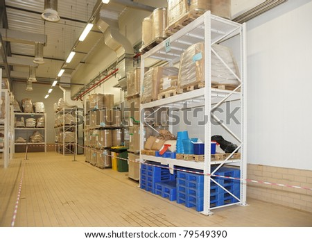 Large food warehouse with steel shelves, copy space - stock photo