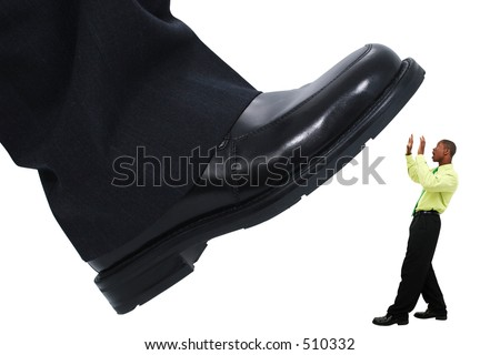 Large foot ready to step down on young business man. Isolated on White. - stock photo