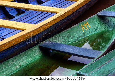 Large fragments of colorful wooden boats, one of them half sunk, Amazonas, Brazil