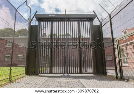 Large gate at an old dutch jail - stock photo