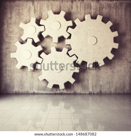 Large gear mechanism in room with concrete walls - stock photo