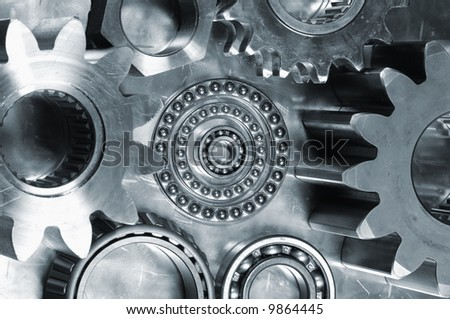 large gears and bearings on display and in a bluish toning concept