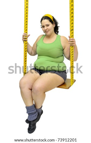 Large girl in a swing made of measuring tape - stock photo