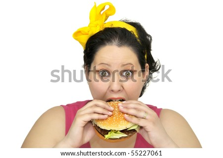 Large girl with hamburger isolated in white - stock photo