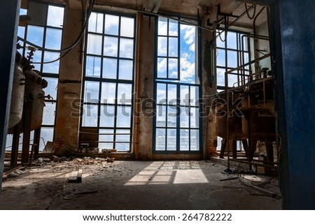 Large glas window inside industrial interior angle shot - stock photo