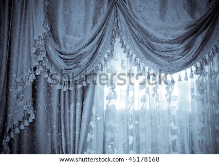 Large golden curtain with spot light - stock photo