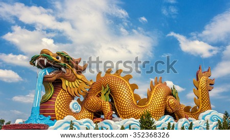 Large golden dragon statue on sky background at Dragon descendants museum, Suphanburi, Thailand