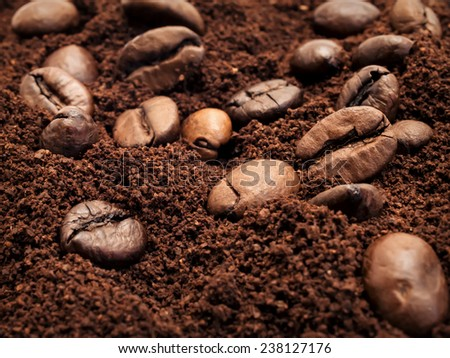 Large grains of black coffee scatterings of ground coffee is used as a background - stock photo