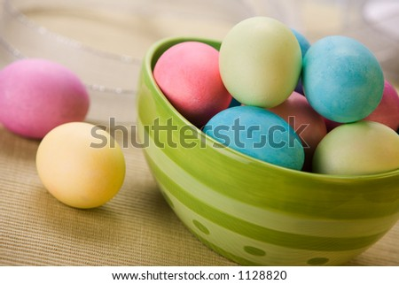 Large green bowl of pastel easter eggs