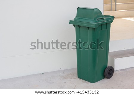 large green wheelie bin for rubbish,Public trash background - stock photo