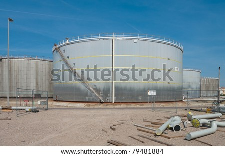 large grey tanks for petrol and oil in the Rotterdam harbor - stock photo