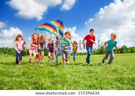 Large group of beautiful kids boys and girls running with kids in the park  - stock photo