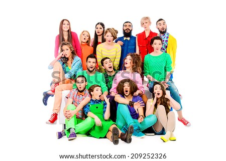 Large group of cheerful young people. Full length portrait. Isolated over white.