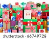 Large group of Christmas Presents of all shapes and sizes. Horizontal format that fills the frame from side to side and white space at the top. - stock photo