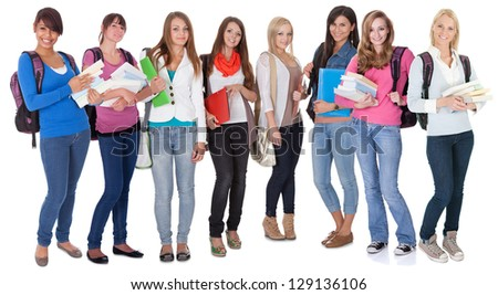 Large group of female students. Isolated on white - stock photo