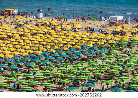Large group of parasols at the beach of Rimini, Itali - stock photo