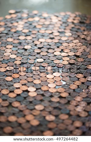 Large group of pennies with short depth of field for a background