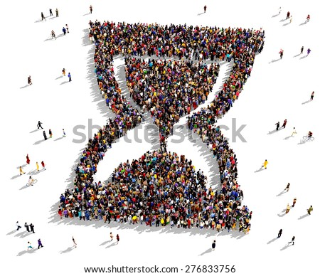 Large group of people seen from above gathered together in the shape of a hourglass - stock photo