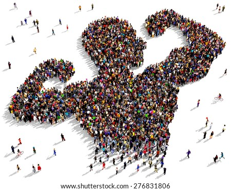 Large group of people seen from above gathered together in the shape of a strong man - stock photo