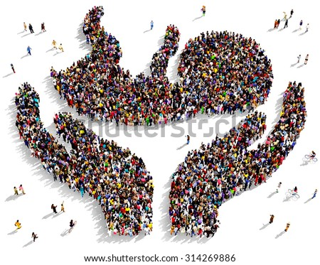 Large group of people seen from above gathered together in the shape of two hands holding a newborn child - stock photo