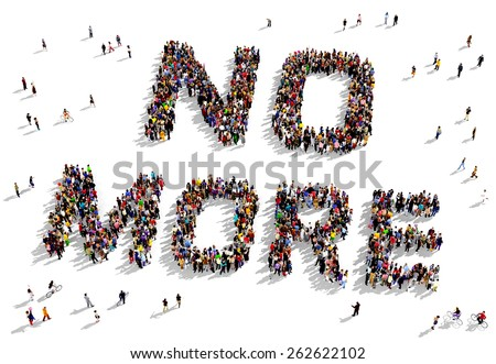 """Large group of people seen from above gathered together to shape the text """"NO MORE""""  - stock photo"""
