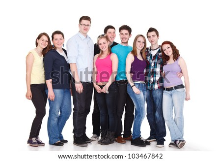 Large group of smiling friends staying together and looking at camera isolated on white background