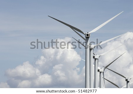 large group of windmills with cloudy sky - stock photo