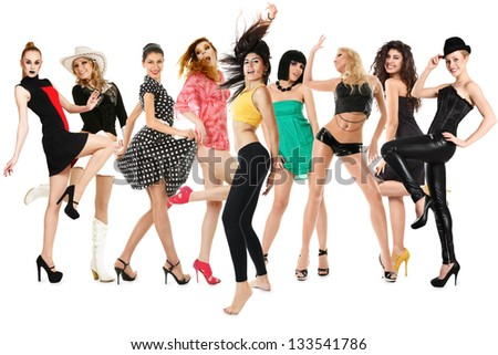 Large group of young dancing women isolated over white background
