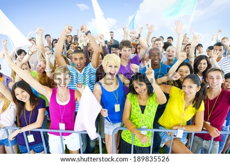 Large group of young people cheering - stock photo