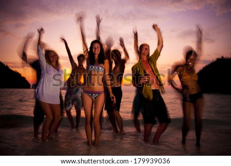 Large Group of Young People Dancing On a Paradise Beach - stock photo
