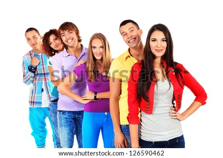 Large group of young people standing together in a row. Friendship. Isolated over white. - stock photo