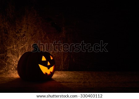 large Halloween jack o lantern Pumpkin with a dark background - stock photo