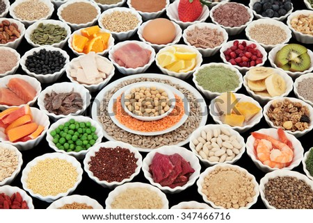 Large health and body building high protein super food of meat, fish, dairy, pulses, cereals, grains, seeds, supplement powders, fruit, vegetable  selection. Selective focus. - stock photo