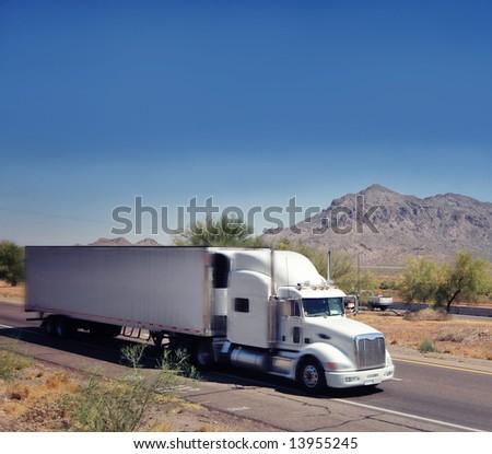 Large heavy goods freight truck speeding through Arizona desert - stock photo